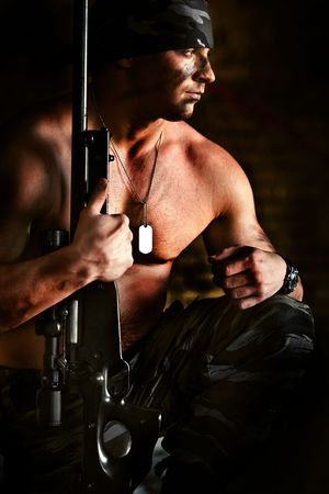 commando: Powerful sniper with the rifle is thinking about war