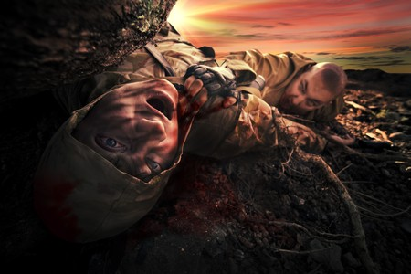apocalypse: Bloody monster near soldiers dead body. Apocalypse background Stock Photo