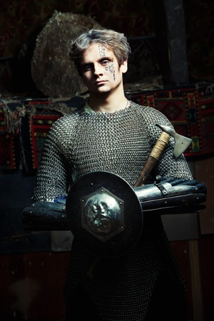 infantryman: Medieval warrior in the chain armour with the axe and shield. Stock Photo