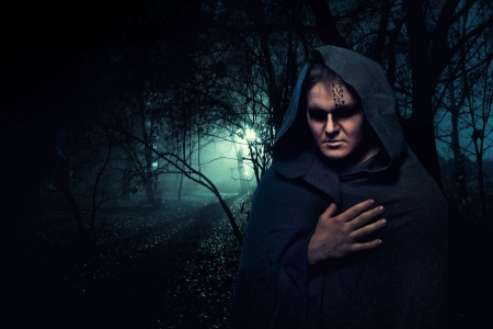 Black monk in the night mystery forest. photo