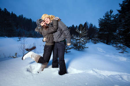 Pretty couple in the winter forest photo