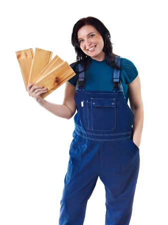 Pretty woman in coveralls with the lining boards. Isolated on white background. photo
