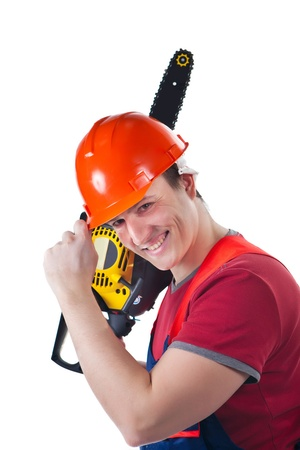 Smiling worker with the chainsaw. Isolated on white background. photo