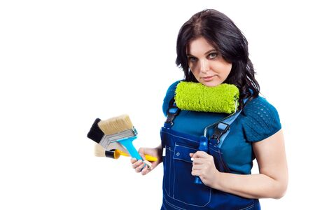 Pretty woman in coveralls with the paintbrushes and roller. Isolated on white background. Stock Photo - 8929067