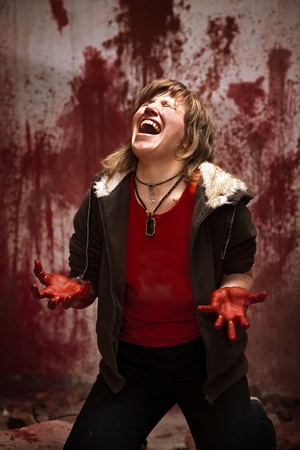 Crying woman with bloodstained hands on the bloody wall background Stock Photo - 9012873