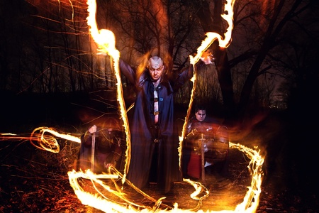 speculative: Black Magician is making fire ceremony. Medieval knights on the background.