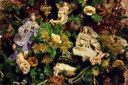 Decoration on the christmas tree. Newborn Jesus with Maria. photo