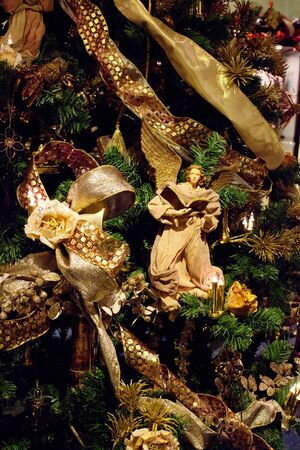 Decoration on the christmas tree. Angel with the Book. photo