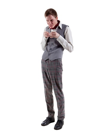 spiteful: Evil grimacing student in checkered pants  Isolated on white