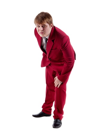malcontent: Malcontent businessman in red suit is watching on you  Isolated on white