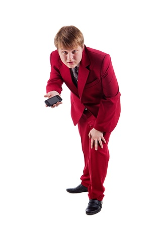 malcontent: Malcontent businessman in red suit is giving you a phone  Isolated on white