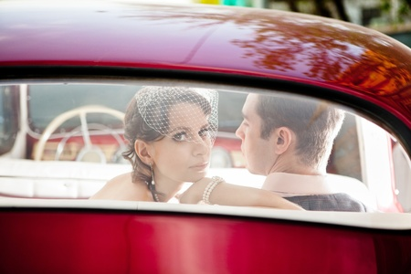 Pretty couple in the back seat of the vintage car. Stock Photo - 13487096