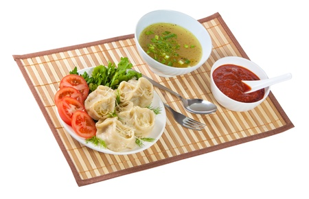 Tasty hinkali with sauces and beef tea. Isolated on white background. Stock Photo - 13684320