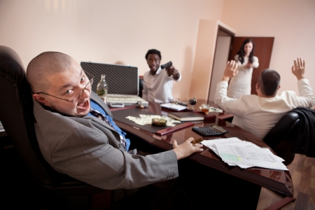holdup: Robbery in the office.  Case of dollars on the background. Stock Photo