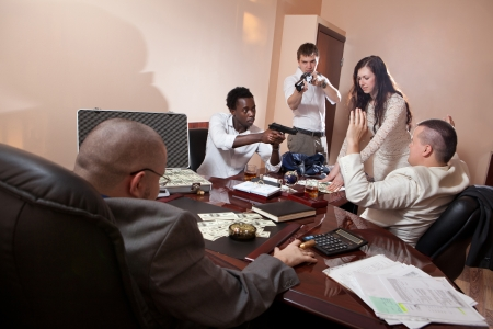 gang: Robbery in the office.  Case of dollars on the background. Stock Photo