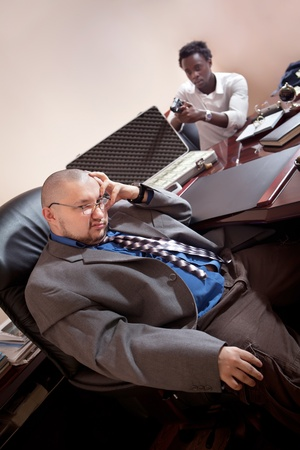 assasin: Robbery in the office.  Case of dollars on the background. Stock Photo