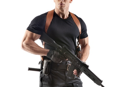 Unrecognizable powerfull police officer in the waist belt with gun  Isolated on white