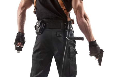 militia: Unrecognizable police officer with handcuffs and gun  Isolated on white  Stock Photo