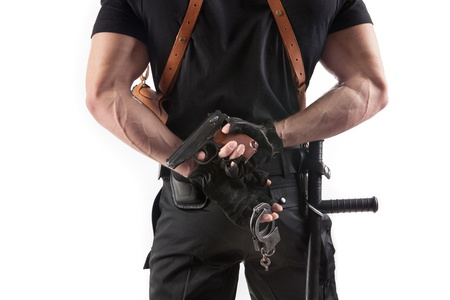 a cudgel: Unrecognizable police officer with handcuffs and gun  Isolated on white  Stock Photo