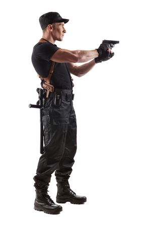 a cudgel: Aiming police officer with gun. Isolated on white.