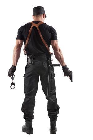 policier: Officier de police avec des menottes et des armes � feu. Isol� sur fond blanc.