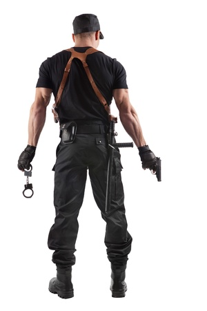 man with gun: Police officer with handcuffs and gun. Isolated on white. Stock Photo