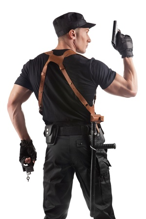Police officer with handcuffs and gun. Isolated on white. photo