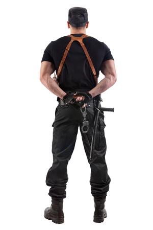 manacles: El oficial de polic�a con las esposas y la pistola. Aislado en blanco.