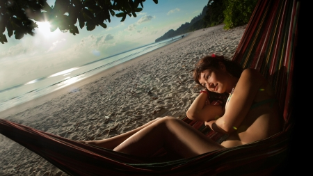 Pretty woman is laying on the hammock on the tropical ocean background. Stock Photo - 18347241