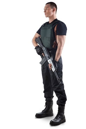 one armed: Police officer in body armour is holding a gun. Isolated on white. Stock Photo