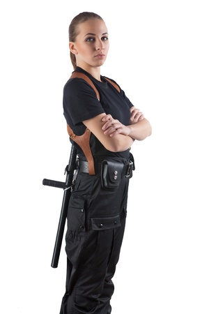 Police officer woman is standing with folding arms  Isolated on white  photo
