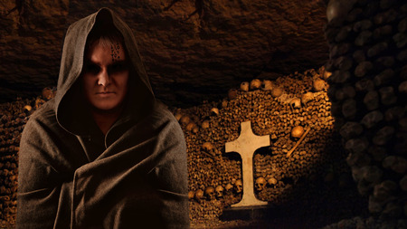 member of the clergy: Praying monk in the dark Paris catacombs  Stock Photo