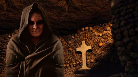 Praying monk in the dark Paris catacombs  Archivio Fotografico