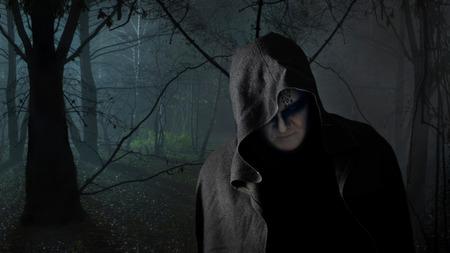 Black monk in the dark forest