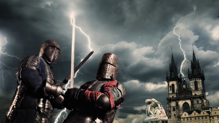 Battle of a medieval knights on the stormy sky background