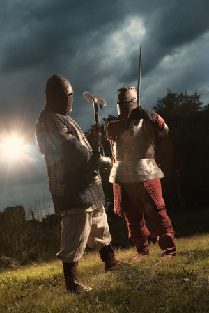 squad: Squad of two medieval knights on the night rural background