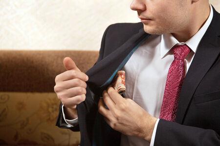 subornation: Businessman is receiving a bribe