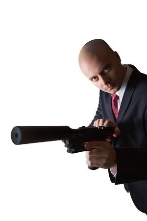 hitman: Bald hitman with the gun. Isolated on white. Stock Photo