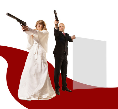 somebody: Pretty couple with the guns is aiming on somebody Stock Photo