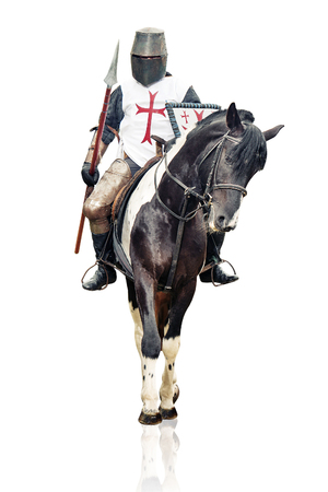 Medieval knight with the lance riding the horse. Stock Photo