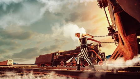 Blond woman in steampunk clothes is pulling a retro train. Another train on the background.