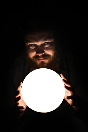 prognosticator: Dark wizard is making magic with the magic crystal.