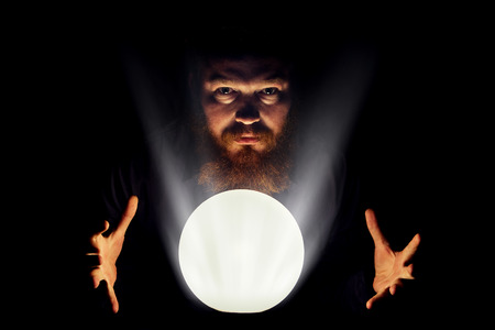 Dark wizard is making magic with the magic crystal. Stock Photo - 46345050