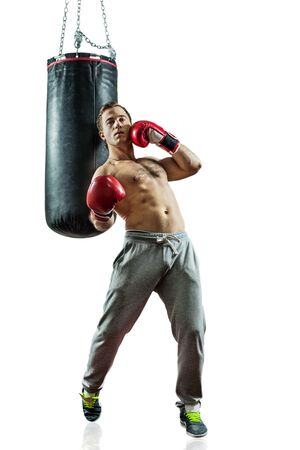 Muscular boxer near the boxing bag. Isolated on white background. Stock Photo