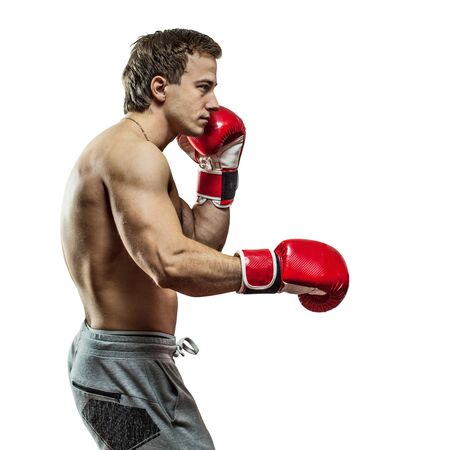 Muscular boxer is boxing. Isolated on white background. Stock Photo