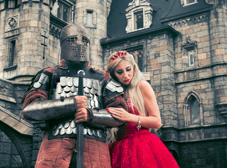 Medieval knight with his beloved lady. Low contrast post processing.
