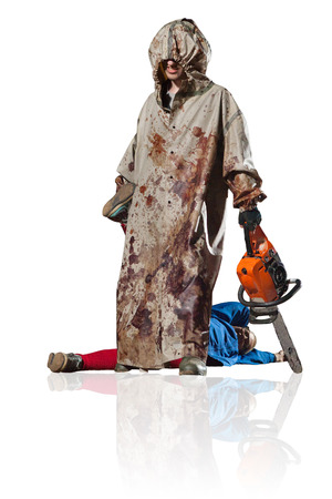 maniac: Maniac with the chainsaw dressed in a dirty bloody raincoat with the dead body. Isolated on white background. Stock Photo