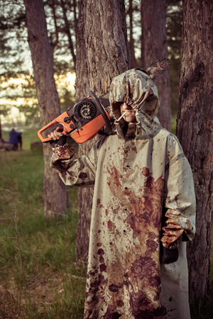 capote: Smoking maniac with the chainsaw dressed in a dirty bloody raincoat.
