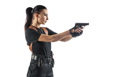 aiming: Woman police officer with gun is aiming. Isolated on white background.