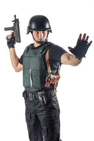 police body: Police officer in body armour is holding a gun. Isolated on white. Stock Photo